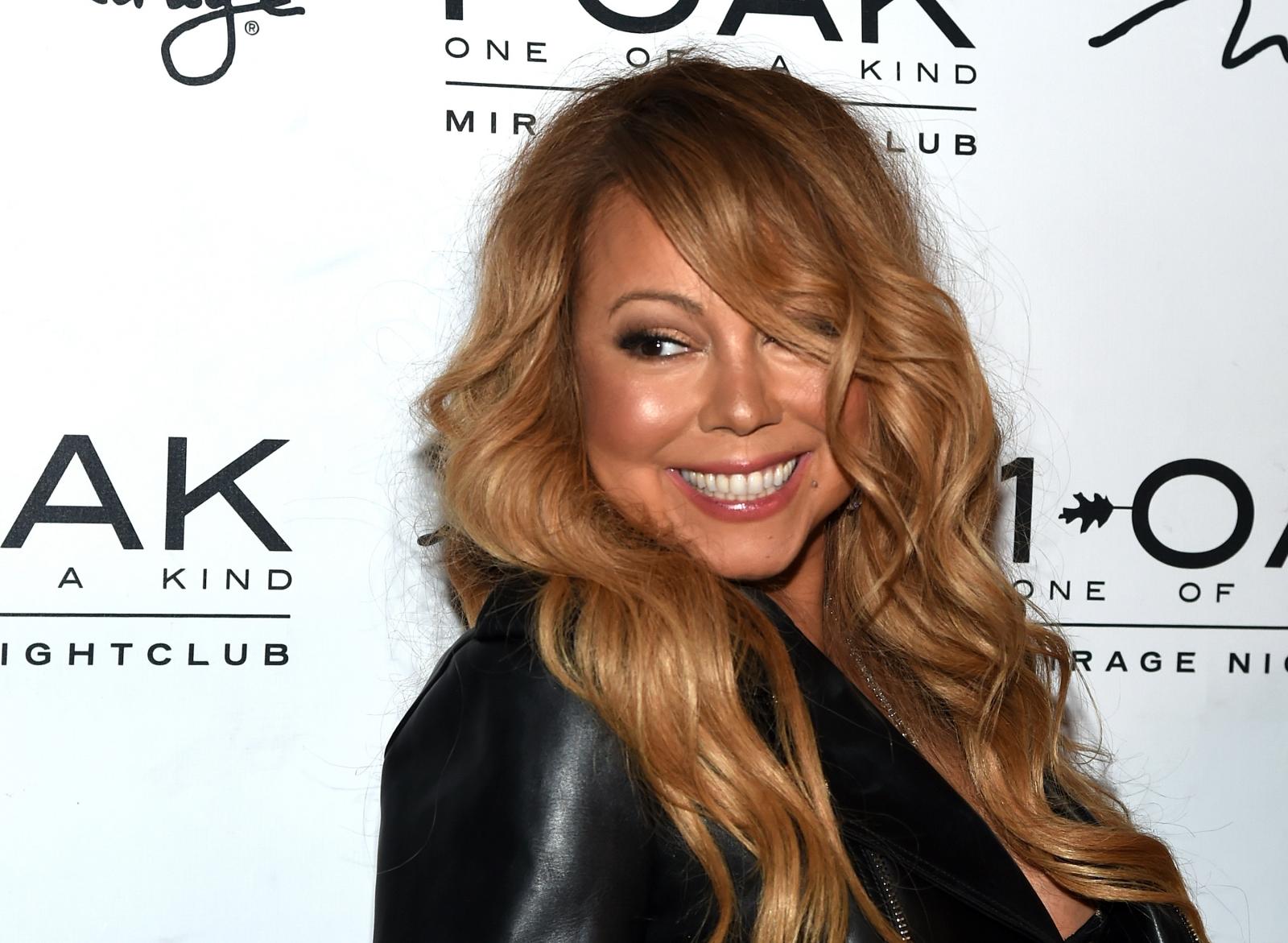 Mariah Carey reveals romance with dancer Bryan Tanaka two months after ...  Mariah Carey