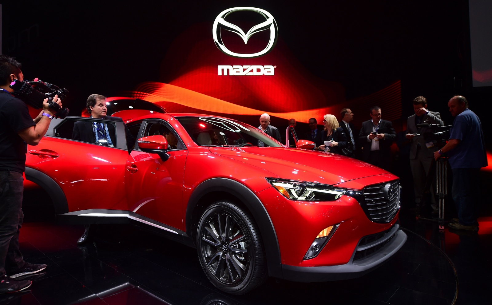 Mazda to recall more than 2 million vehicles worldwide over defected tail gate and engine problems