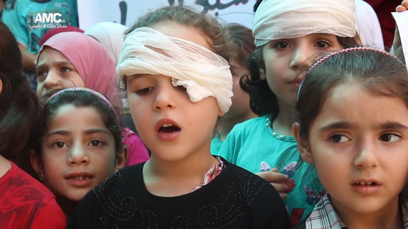 Aleppo children sing to be saved