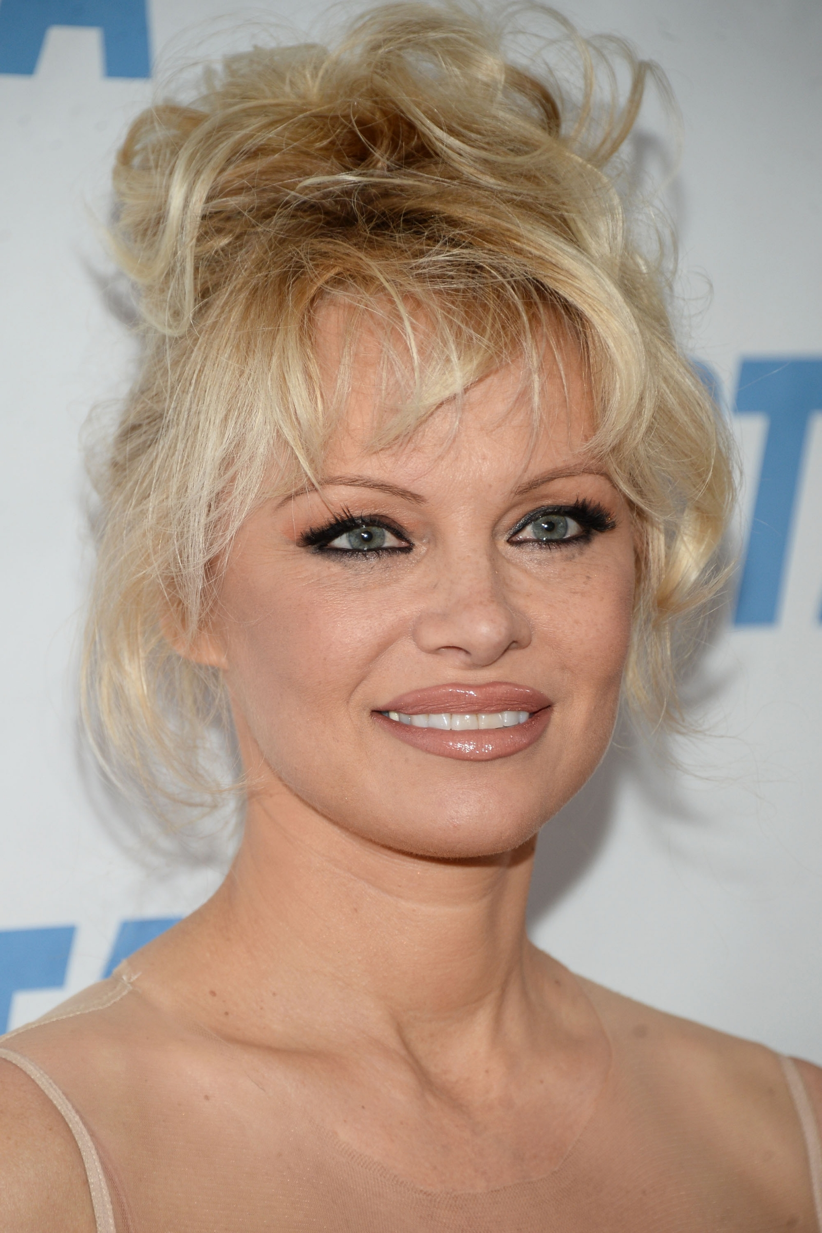 Pamela Anderson: Former Playboy model urges men to stop ...