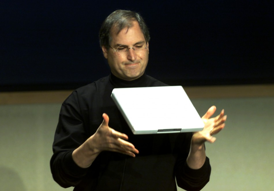 APPLE CEO STEVE JOBS DEMONSTRATES NEW NOTEBOOK COMPUTER.