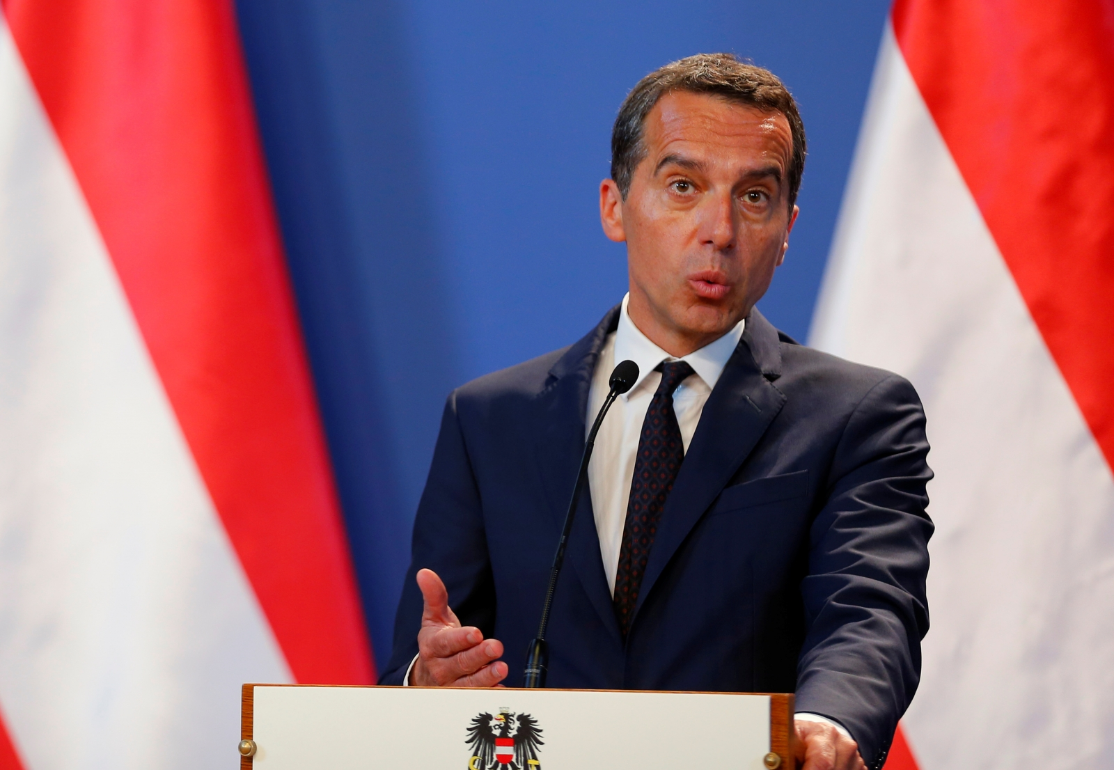 Multinationals like Starbucks and Amazon 'pay less tax than a sausage stand', Chancellor of Austria says