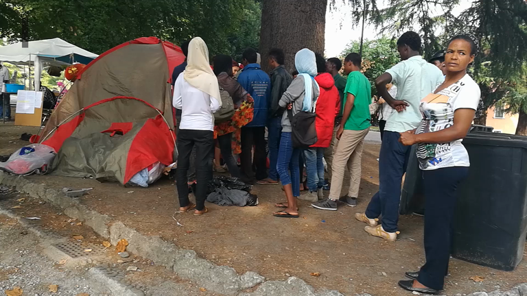 Refugee crisis: Makeshift camps outside San Giovanni train station in Como City