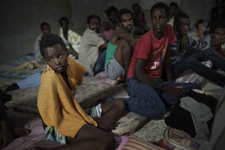 12-year-old Sagga, from Eritrea, sits with other adolescent boys
