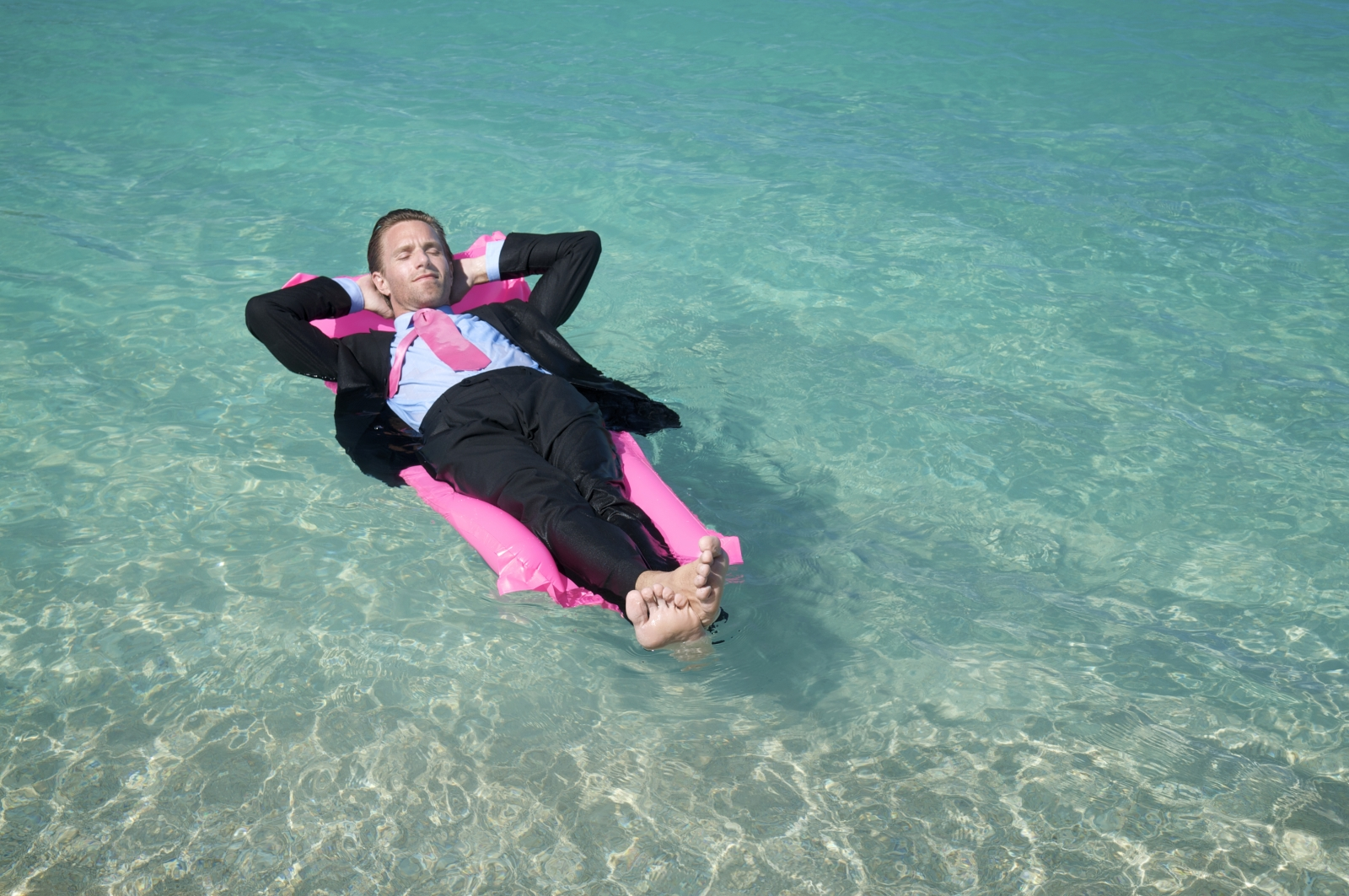 Businessman relaxes on lilo