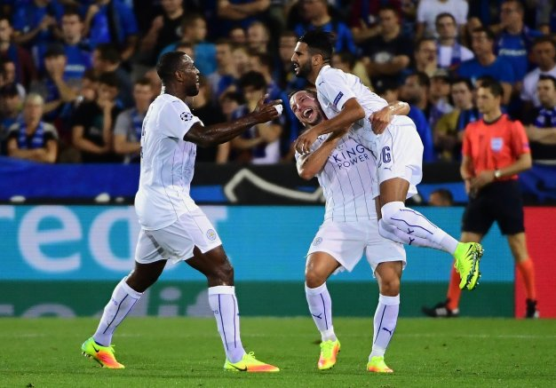 Leicester City players celebrate scoring