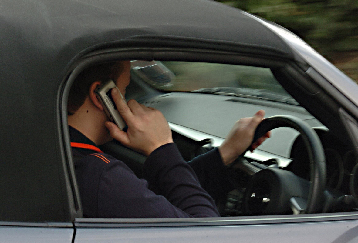 How many drivers are caught using mobile phones while ...