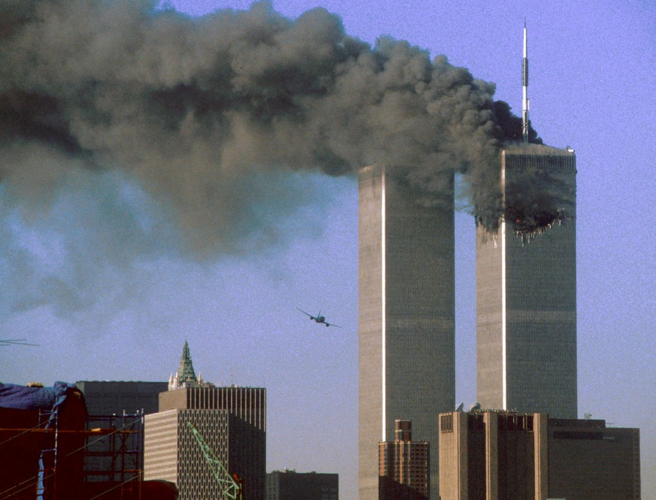 Hijacked United Airlines Flight 175 (L) flies toward the World Trade Center twin towers shortly