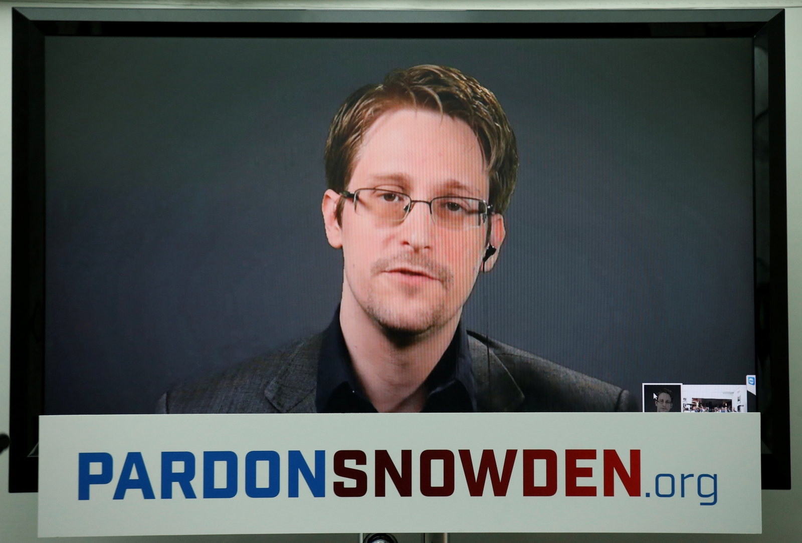 Edward snowden speaks via video link during a news conference in new