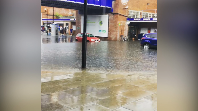 UK storms cause flash flooding and travel delays