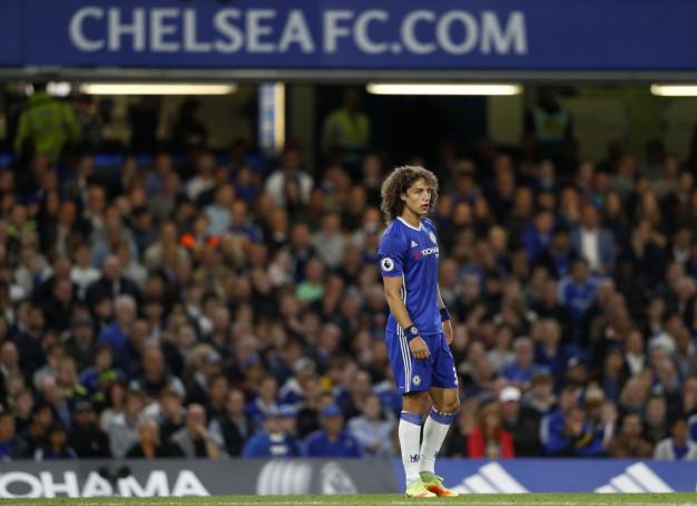 David Luiz watches on