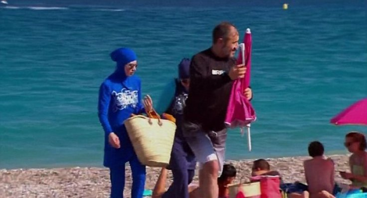 Woman wears burkini on beach in protest