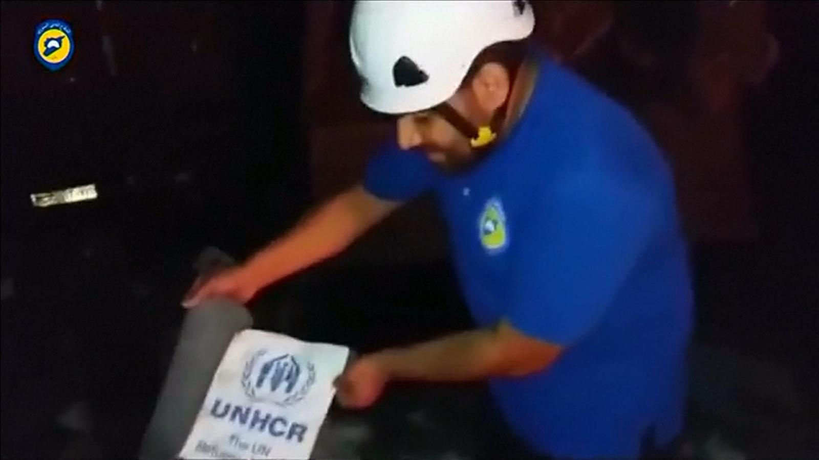 Syrian Civil Defense at destroyed UN aid