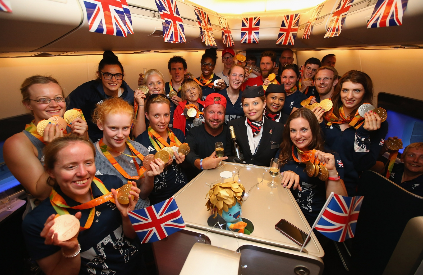 Team GB on board their flight home