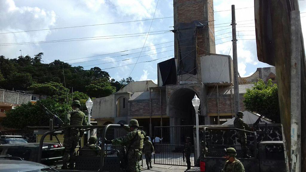 Mexican soldiers arrive at the Nuestra Senora de Fatima church after the catholics priests Alejo Nabor Jimenez Juarez and Jose Alfredo Juarez de la Cruz were kidnapped by gunmen