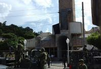 Mexican soldiers arrive at the Nuestra Senora de Fatima church after the catholics priests Alejo Nabor Jimenez Juarez and Jose Alfredo Juarez de la Cruz were kidnapped by gunmen