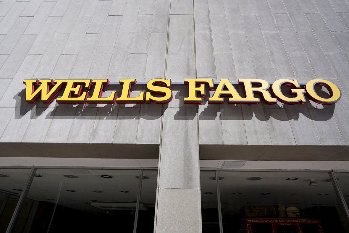 Wells Fargo & Company (NYSE:WFC) Position Decreased by V Wealth Management LLC