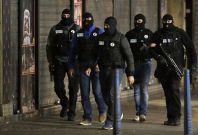 French police patrol Saint Denis, Paris, followingthe