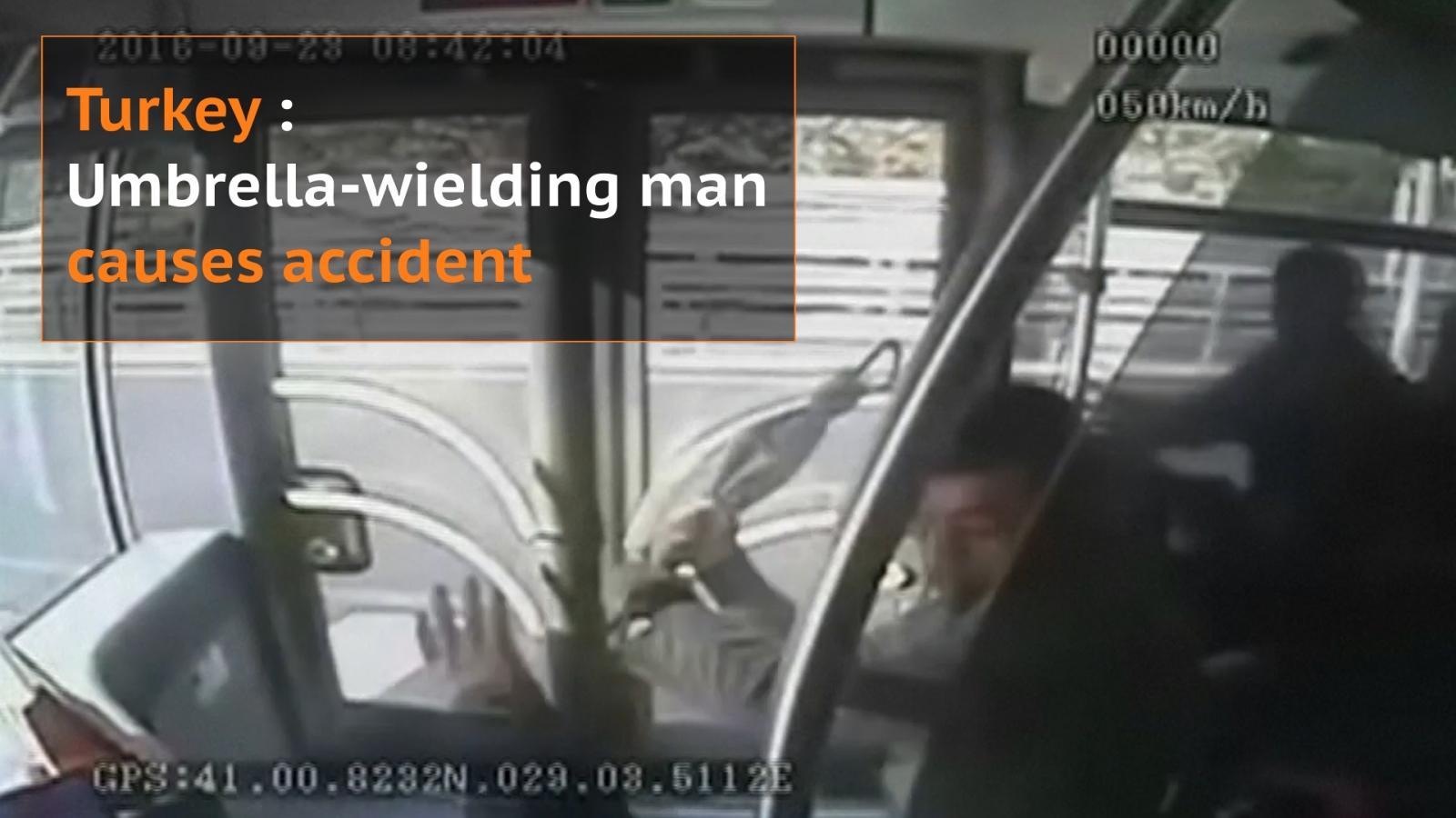 Umbrella-wielding man causes accident