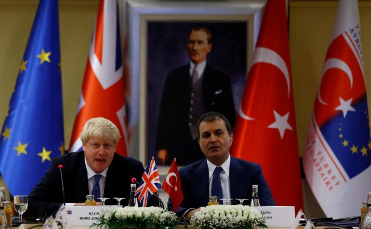 Boris Johnson and Omer Celik