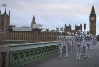 Watch humanoid robots walking through London