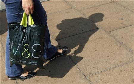 A shoppers carries a Marks and Spencer bag on Oxford Street in London