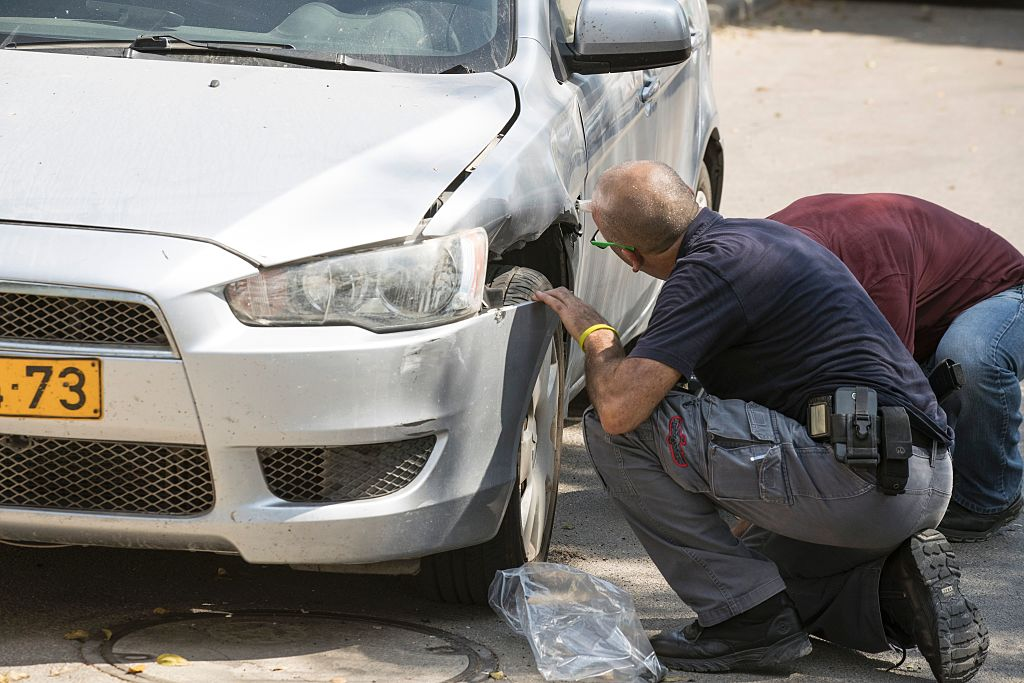 Police ninspect the damage after a rocketattack