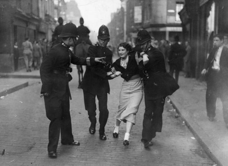 Policemen arresting a demonstrator