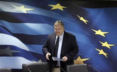 Greece's Finance Minister Evangelos Venizelos arrives for a news conference in Athens