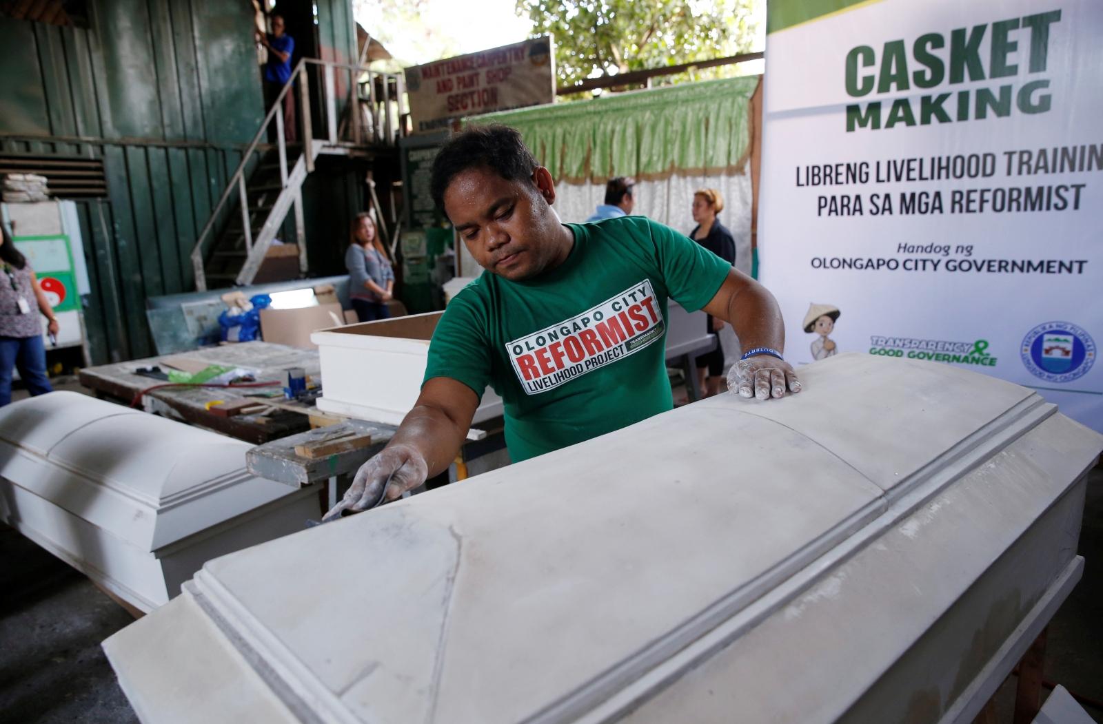 A former drug user undergoing rehabilitation makes coffins