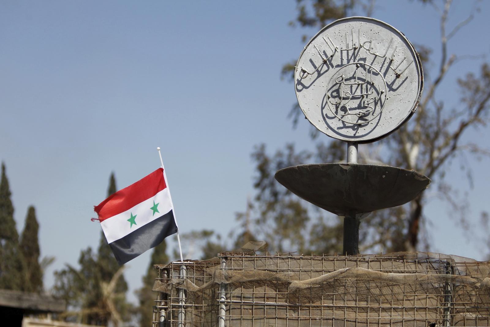 Syria flag near Isis slogan