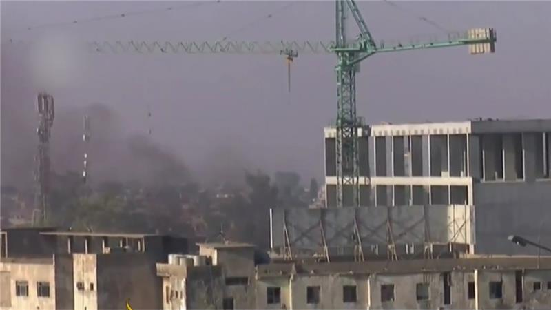 smoke rises over Kirkuk