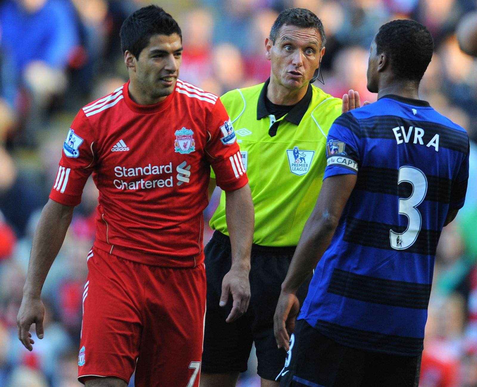 Luis Suarez (left) and Patrice Evra
