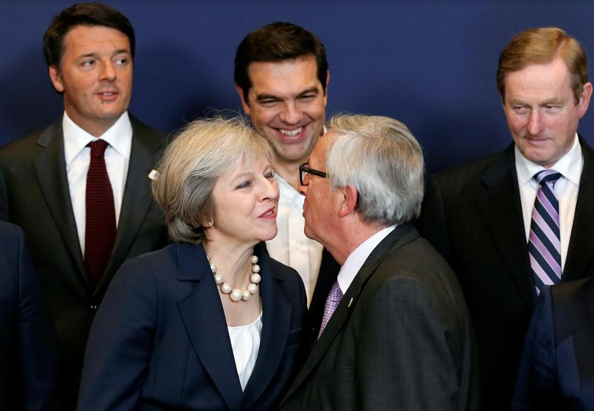 European Commission President Jean-Claude Juncker kisses Britain's Prime Minister Theresa May