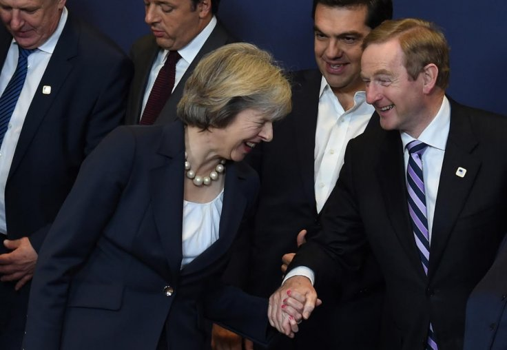 Theresa May (L) laughs with Ireland's Prime minister Enda Kenny