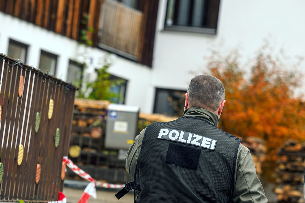 policeman is pictured on October 19, 2016 in Georgensgmuend, southern Germany, in front of a house of a member of the so-called Reichsbuerger movement.