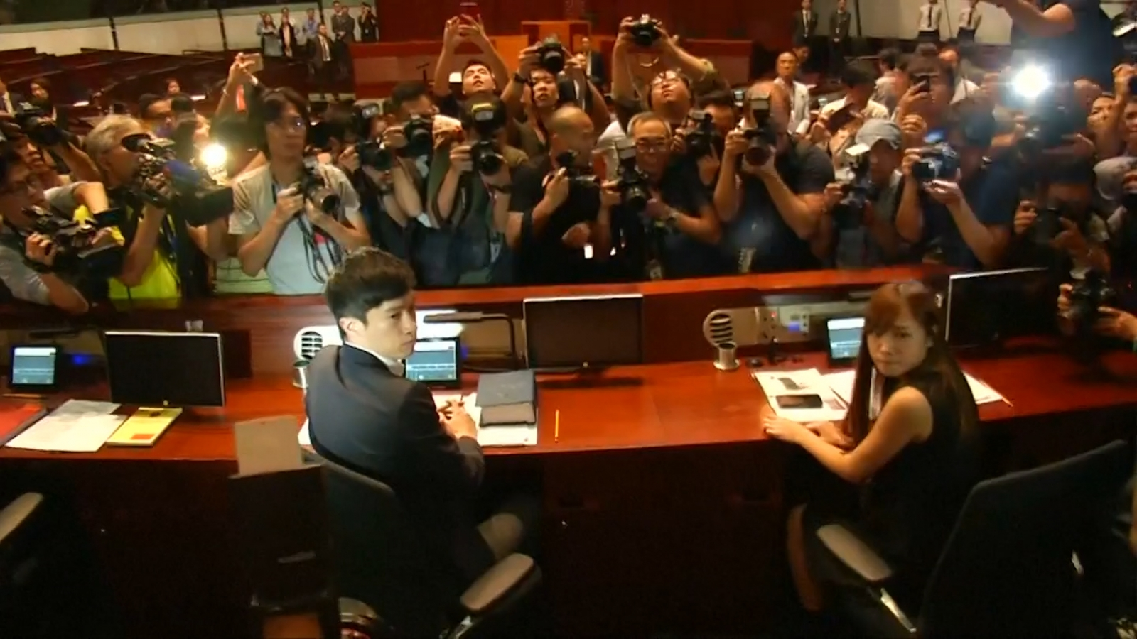 Hong Kong pro-independence lawmakers storm council chamber