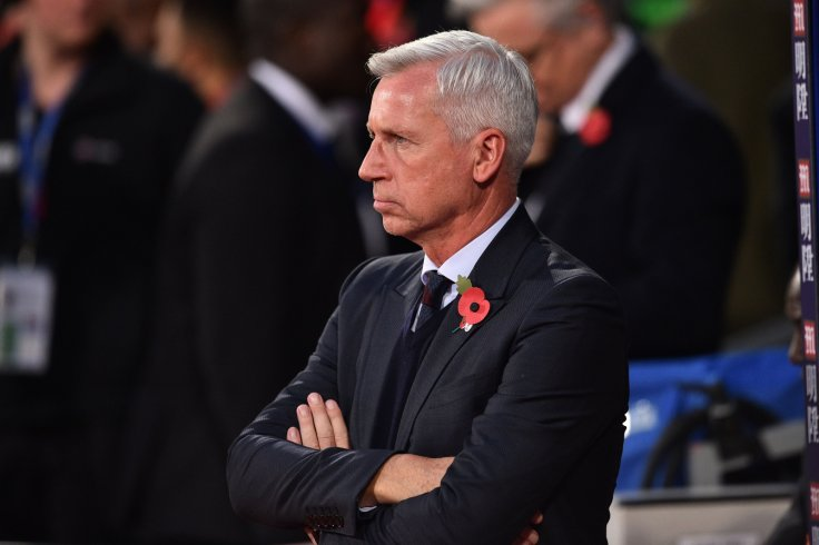 Alan Pardew watches on