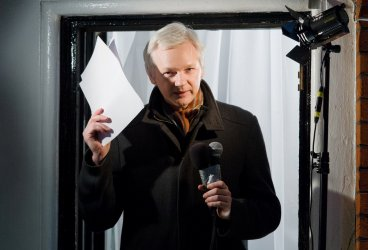 Julian Assange claims Libya was Hillary Clinton's war, FBI out for payback over her resistance