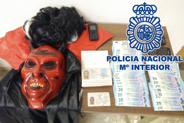 Hamid Hakkar arrested by police wearing a Devil costume.