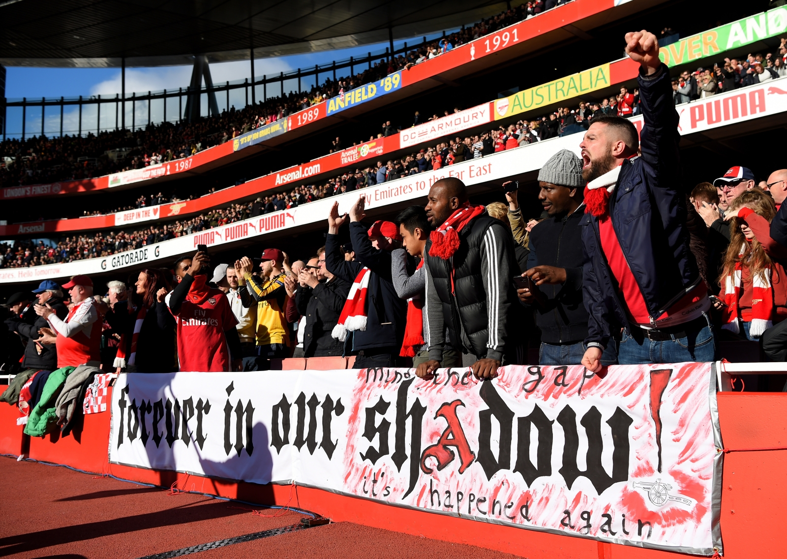 Arsenal fans cheer their side on