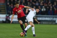 Michael Carrick wins the ball