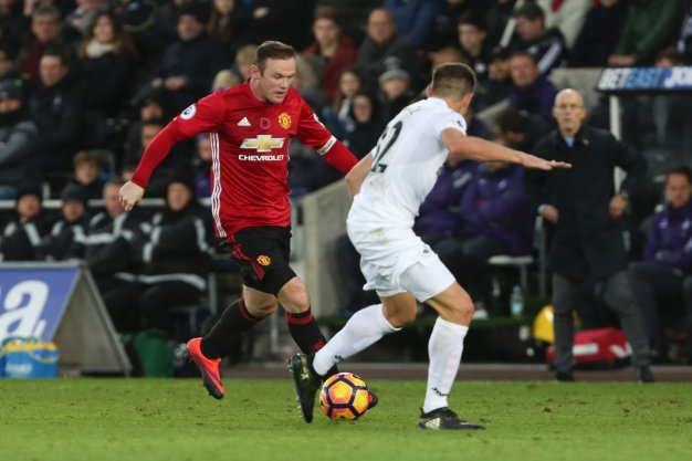 Wayne Rooney on the ball