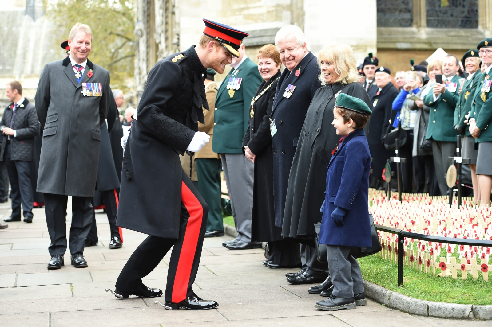 Prince Harry joking with a child