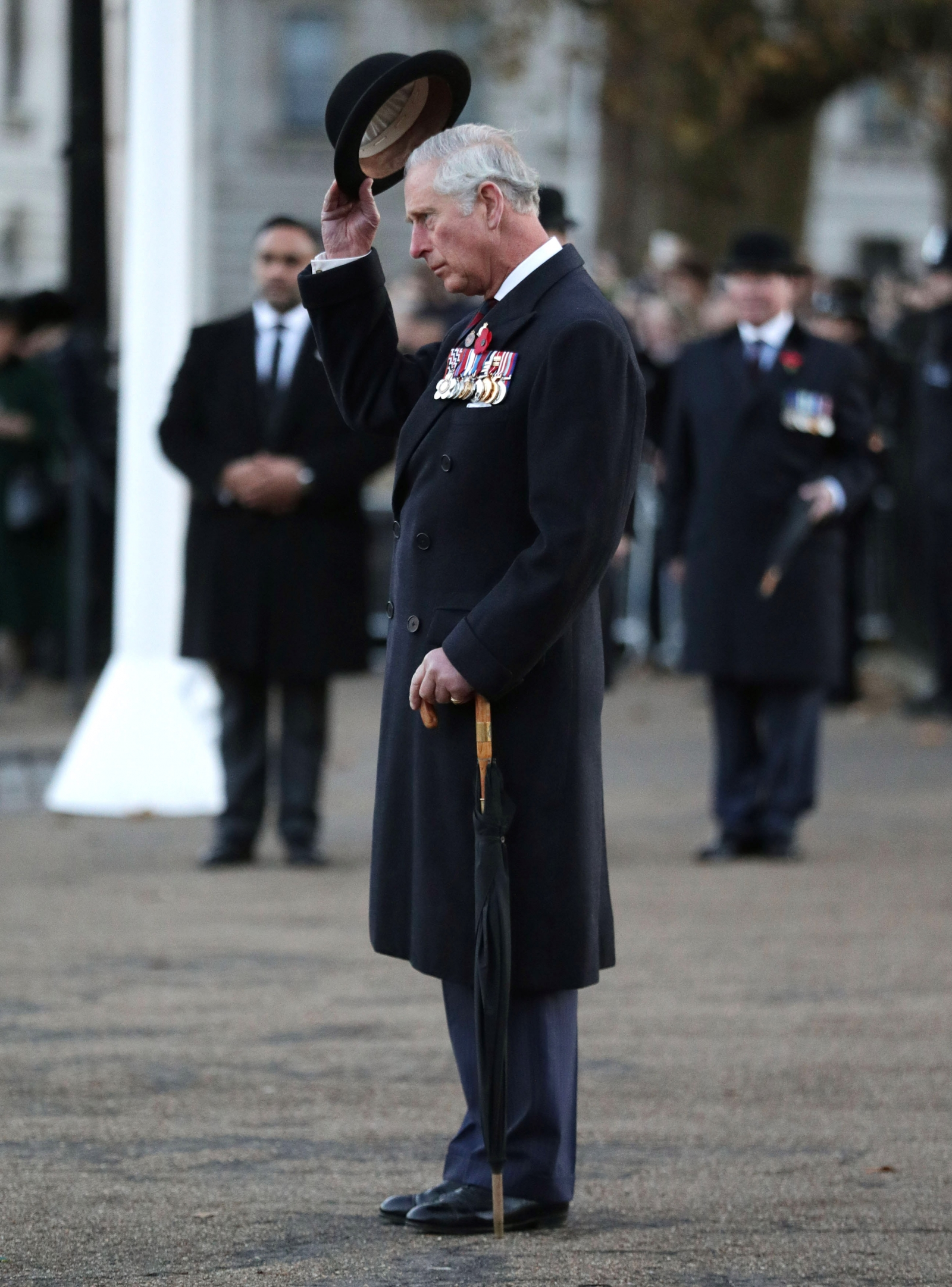 Prince Charles doffs his hat