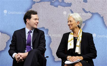 Britain's Chancellor of the Exchequer, Osborne and IMF Managing Director Lagarde speak to each other at Chatham House in central London