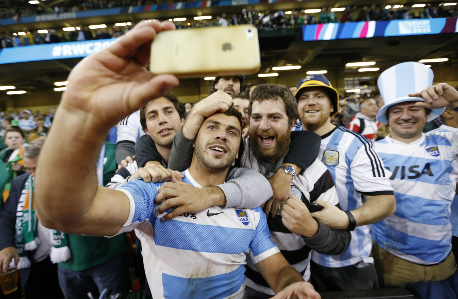 Argentine rugby player poses with fans