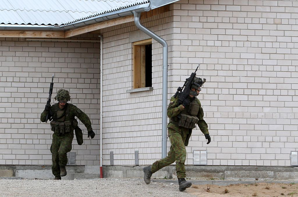 Lithuanian army soldiers take part in an exercise following the official opening of a military training centre for urban warfare in Pabrade, Lithuania, on August 30, 2016.