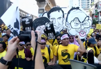 Malaysia painted red and yellow as pro and anti-government supporters rally in the capital