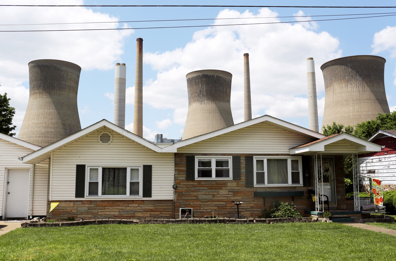 Coal plant seen behind West Virginia home